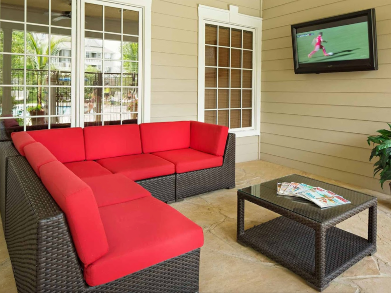 This image shows the community amenities, particularly the outdoor tv lounge featuring its comfy sofas that were ideal for family and friends bond.